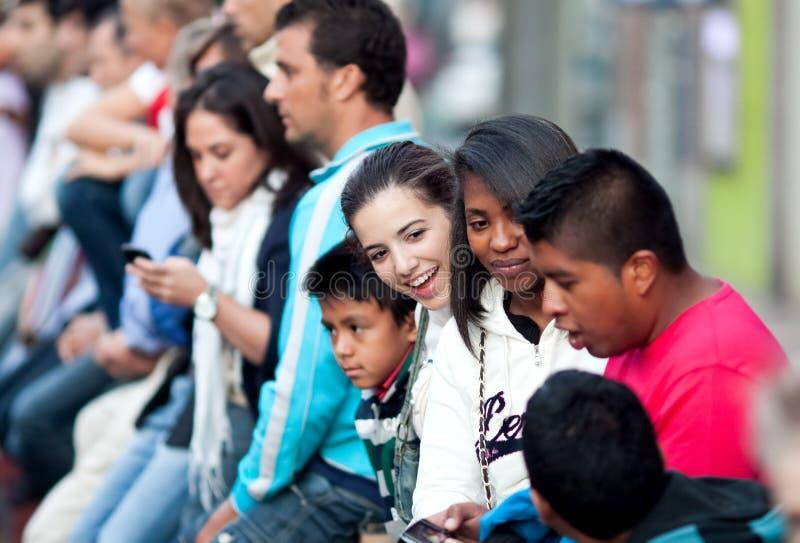MADRID SUBURB OF SAN SEBASTIAN DE LOS REYES - SEPTEMBER 30: Spec. Tators sit on the fence waiting for the race bulls in San Sebastian de los Reyes during royalty free stock photo