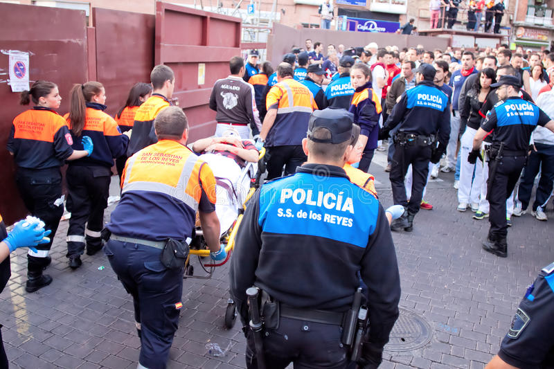 MADRID SUBURB OF SAN SEBASTIAN DE LOS REYES - SEPTEMBER 29: A wounded man carried away on a stretcher in San Sebastian de los. Reyes during festival, Spain in royalty free stock photography
