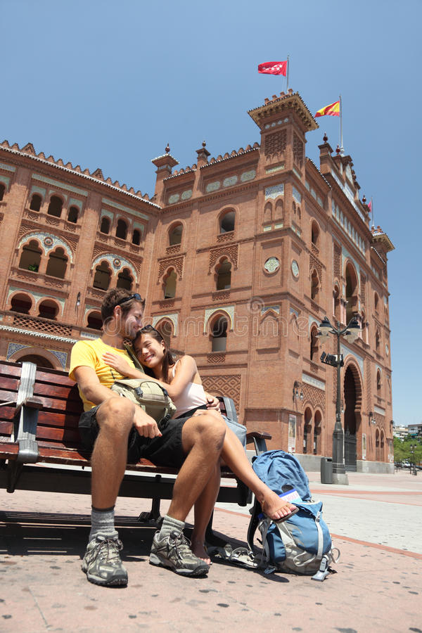 Madrid tourists - Toros de Las Ventas, Spain. Happy couple travelling in Spain, in front of the bullfighting arena Plaza de Toros de Las Ventas in Madrid royalty free stock image
