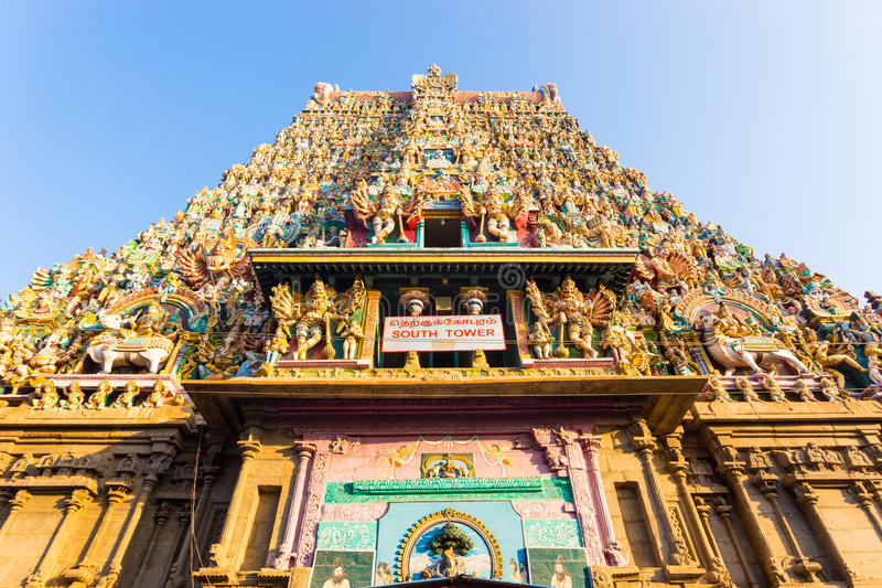 Madurai Meenakshi Amman Temple South Tower Gateway. South gateway tower covered in statues of gods at the Meenakshi Amman Temple on a sunny day in south Indian royalty free stock photos