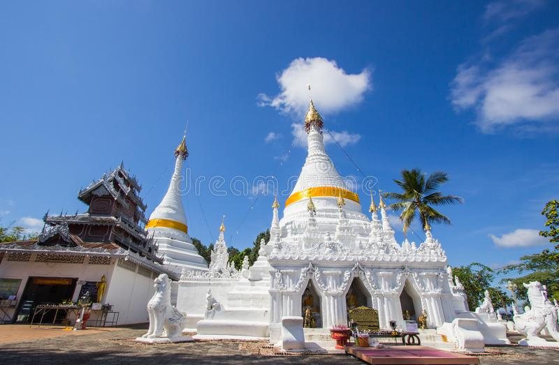 Mae Hong Son province,Northern Thailand on November 19,2017: Burmese style white chedis with beautiful sky at Wat Phra That Doi Ko royalty free stock images