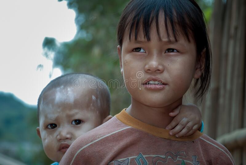 Mae Hong Son, Thailand - Jan 22, 2010 : Refugee people, A refugee girl and a little boy living in a refugee camp in Thailand, royalty free stock photos