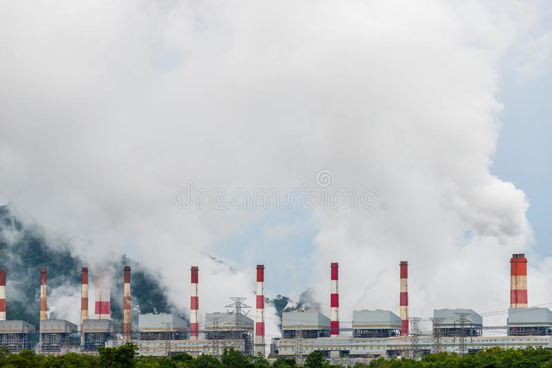 Mae Moh coal power plant in Lampang, Thailand. Blue, building, chimney, combustion, construction, electricity, emission, energy, environment, factory, fuel royalty free stock images