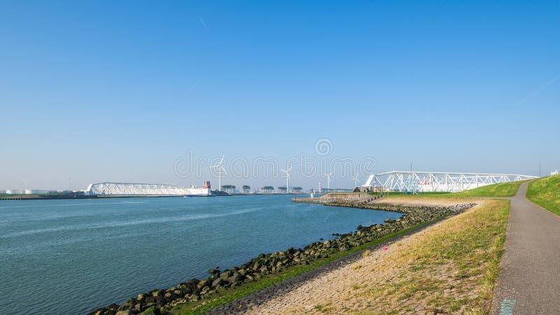 The Maeslantkering, a huge storm surge barrier on the Nieuwe Waterweg, Netherlands. The Maeslantkering is a huge storm surge barrier on the Nieuwe Waterweg. The stock photo
