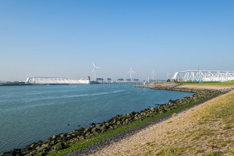 The Maeslantkering, a huge storm surge barrier on the Nieuwe Waterweg, Netherlands. The Maeslantkering is a huge storm surge barrier on the Nieuwe Waterweg. The stock image