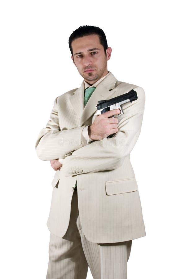 Maffia met gekruiste armen en een gunonhand stock afbeeldingen