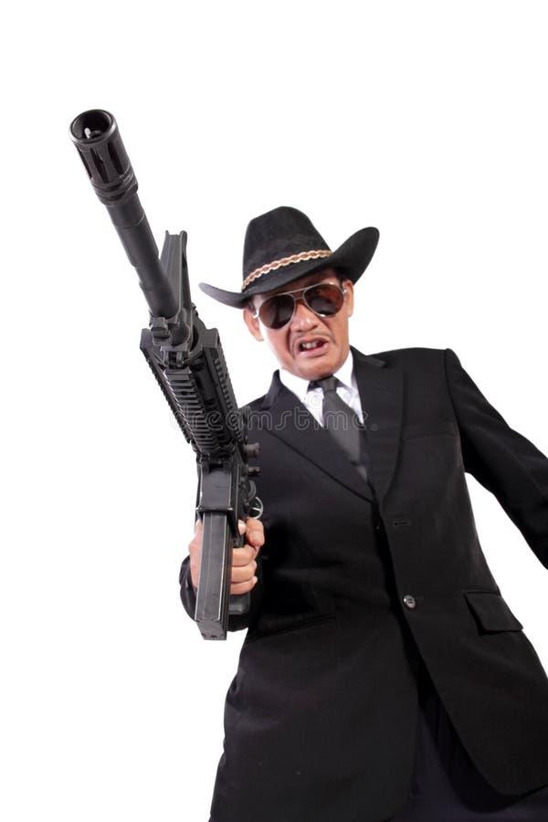 Mafia mit spitzem Gewehr stockfotos
