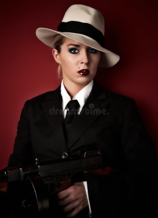 Mafia-protuberancia femenina fotos de archivo