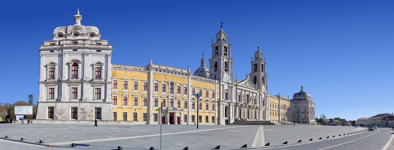Mafra National Palace, Convent and Basilica. Mafra, Portugal - September 02, 2013: Locals stroll in front of the Mafra National Palace, Convent and Basilica royalty free stock images