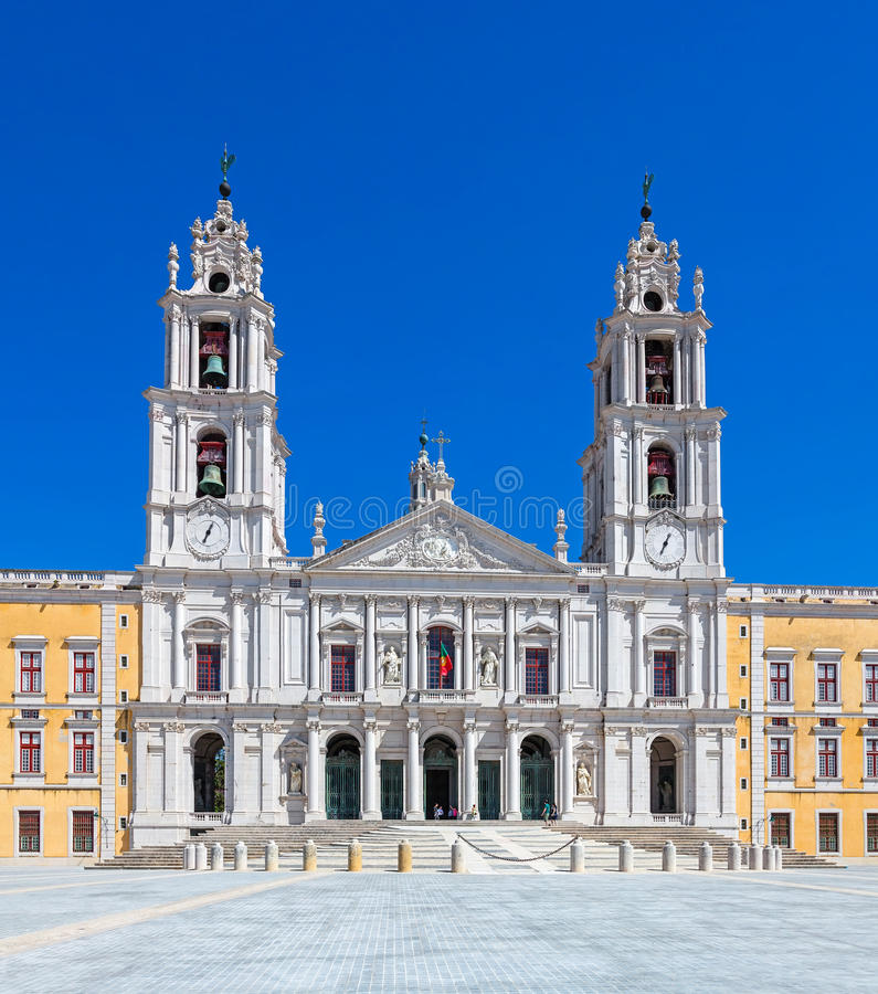 Mafra National Palace, Convent and Basilica in Portugal. Mafra, Portugal - September 02, 2014: Tourists stroll in front of the Mafra National Palace, Convent and stock photo