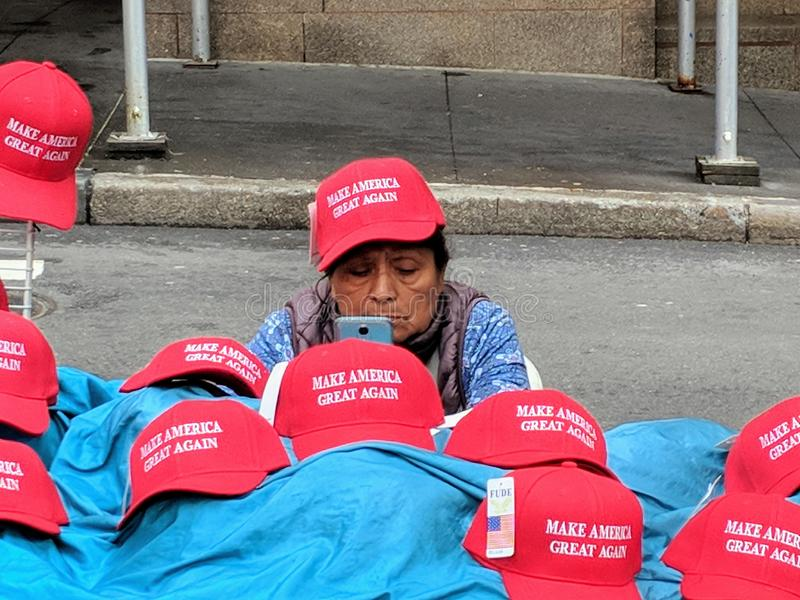 MAGA Hats. Women selling & x22;Make America Great Again& x22; hats in Zucotti Park in Lower Manhattan royalty free stock image