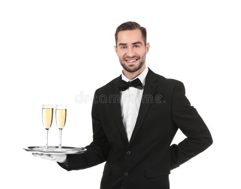Magasin för uppassareinnehavmetall med exponeringsglas av champagne royaltyfri bild