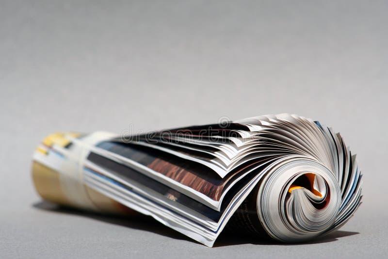 Magazine de Rolledup de fond photos stock