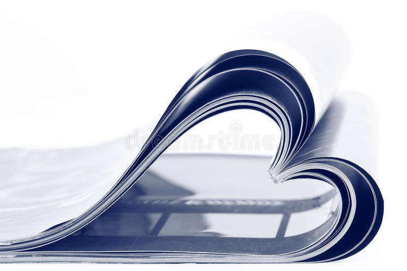 Magazine folded into a heart shape royalty free stock image