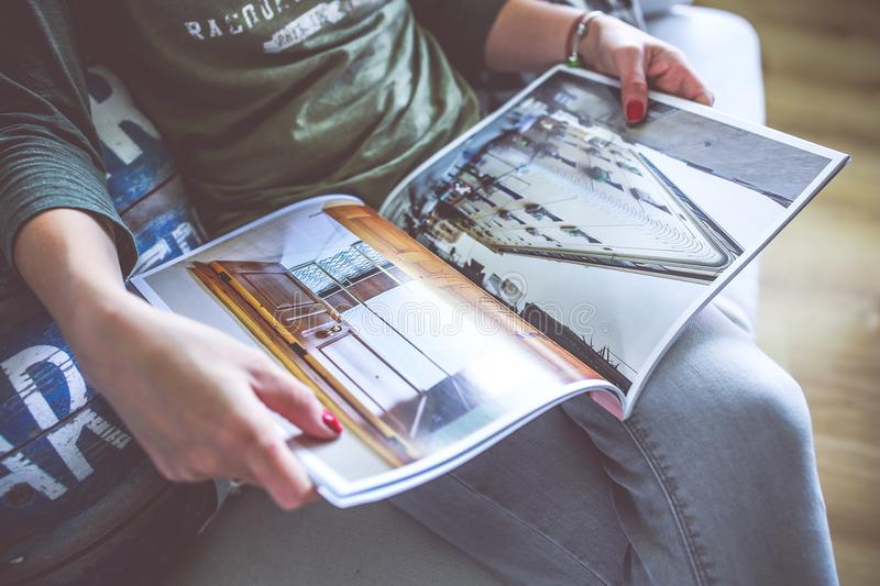 Magazine in the hands royalty free stock photo