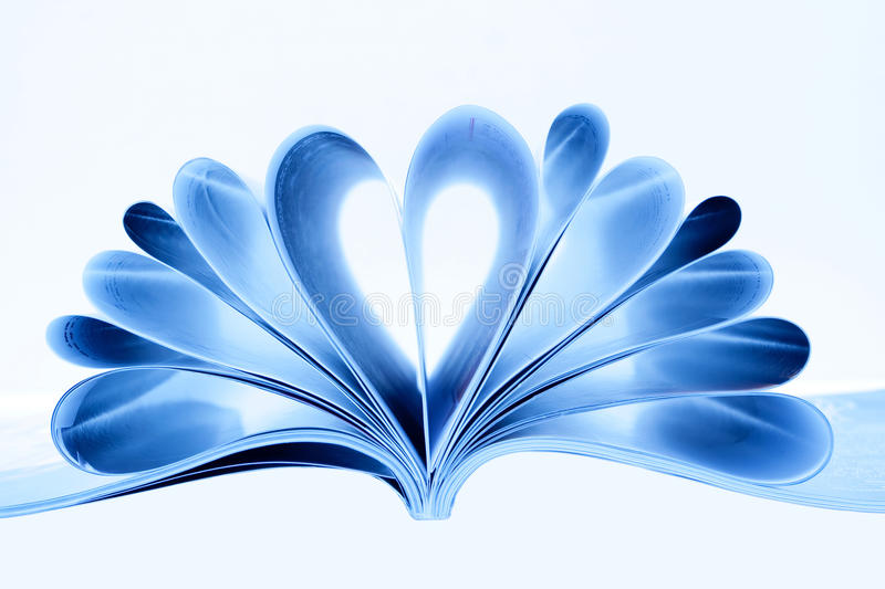 Magazine Heart Shape. Heart shape with blue pages of magazine royalty free stock images