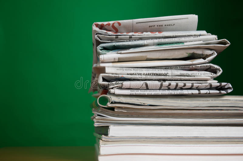Magazine and Newspaper. Stack of reading and research magazines and newspaper, a fading way we find information today royalty free stock photos