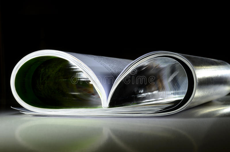 Magazine on reflective surface royalty free stock photos