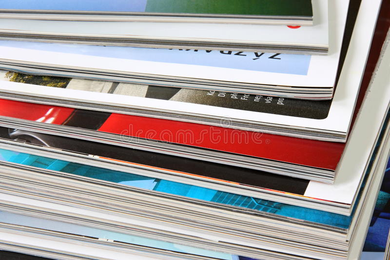 Magazines. Detail pile of color magazines stock image