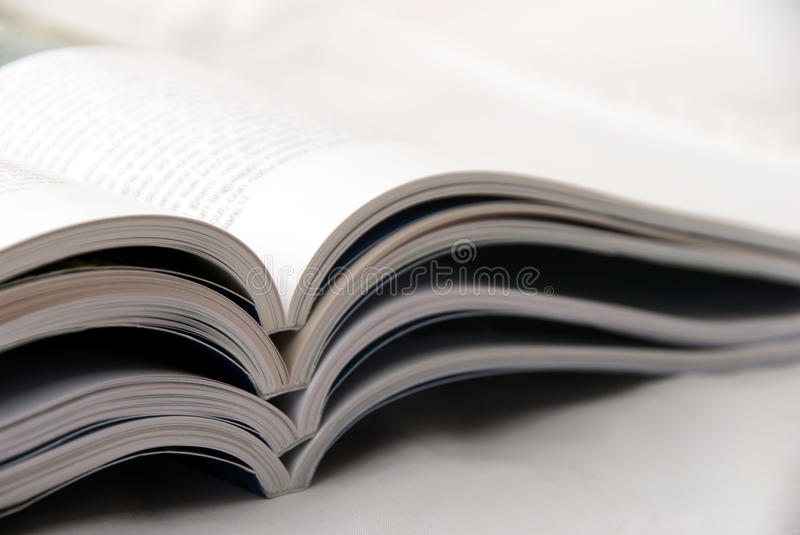 Magazines. A stack of open magazines royalty free stock photo