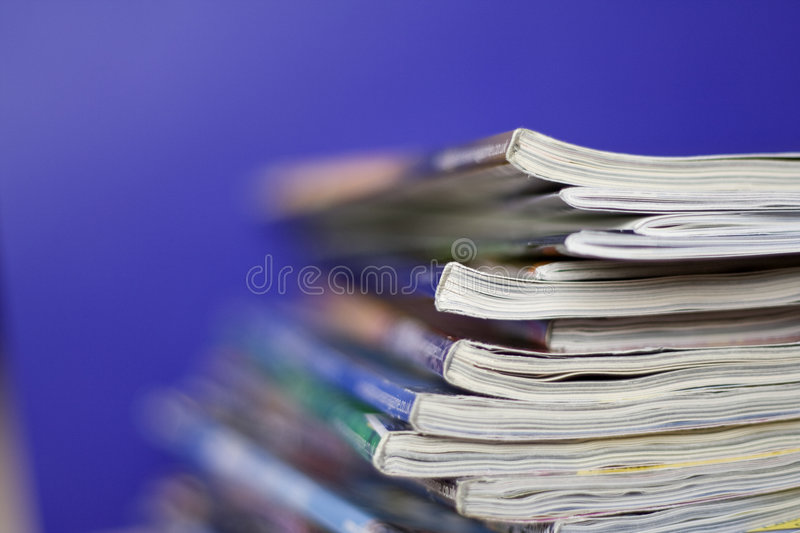 Magazines. Stack of different magazines lying on the table stock photo