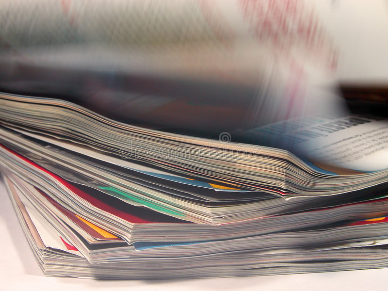 Magazines. With a riffling blur aspect royalty free stock photo