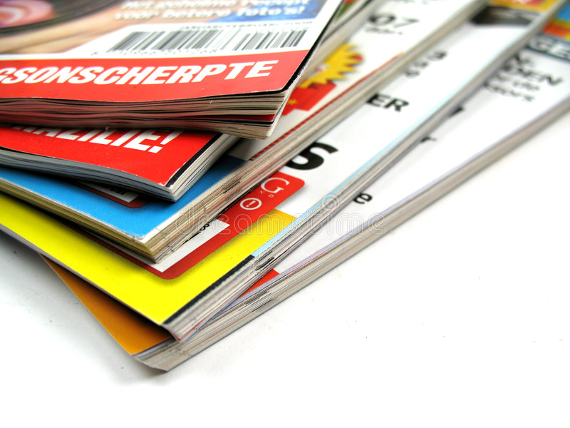 Magazines. A pile of magazines on white background royalty free stock photography