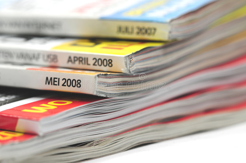 Magazines. A stack of well read magazines stock photography