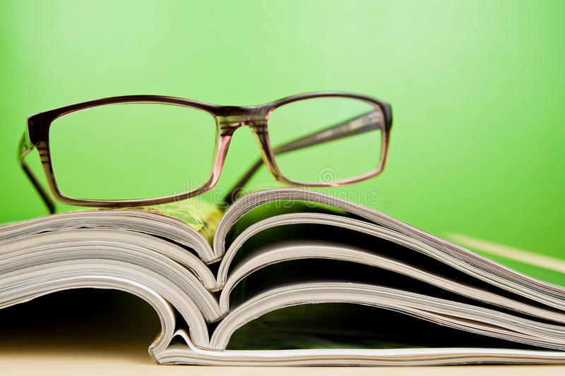 Download Magazines And Glasses Lying On Table Stock Photo - Image: 10855190