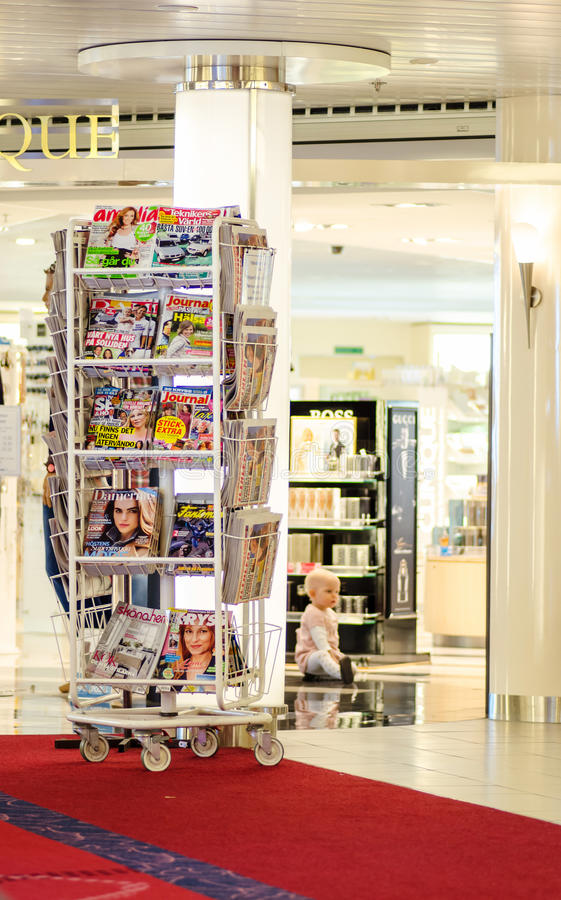 Magazines and journals stand royalty free stock photo