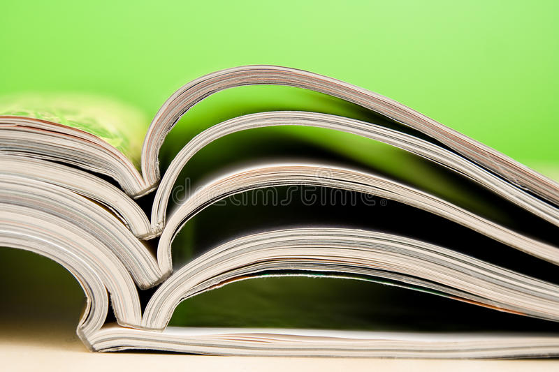 Magazines lying on table royalty free stock photography