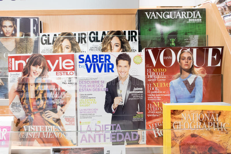 Magazines in spain. Magazines in a spanish newsstand with copyspace stock image
