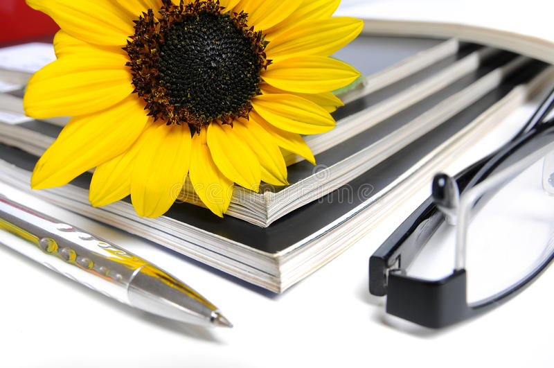 Magazines with sunflower stock photography