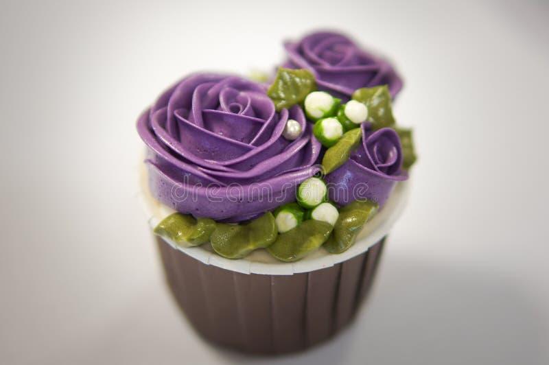 Magdalenas coloridas para el cumpleaños foto de archivo libre de regalías