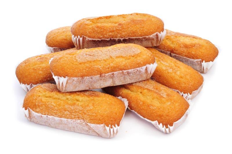 Magdalenas largas, typisk spanjor plattar till muffin arkivbilder