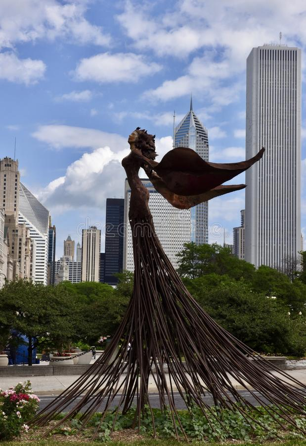 Magdalene. This is a Summer picture of a public art piece titled Magdalene on the Congress Triangle Garden with the Chicago skyline as a background under a blue stock images