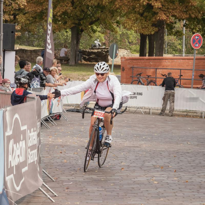 Magdeburg, Germany - 15 September 2019: Road bicycle racing. Female cyclist is near the finish line. Seniors are staying young by stock images