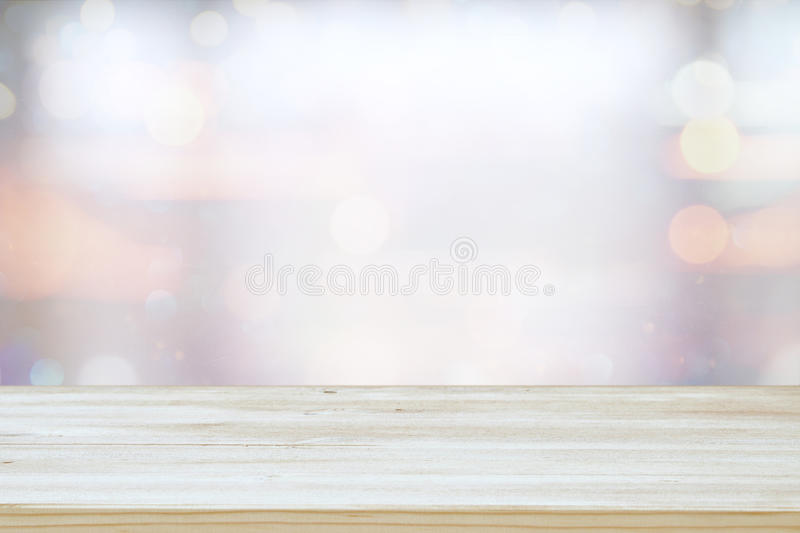 mage of wooden table in front of abstract blurred window light background royalty free stock photo