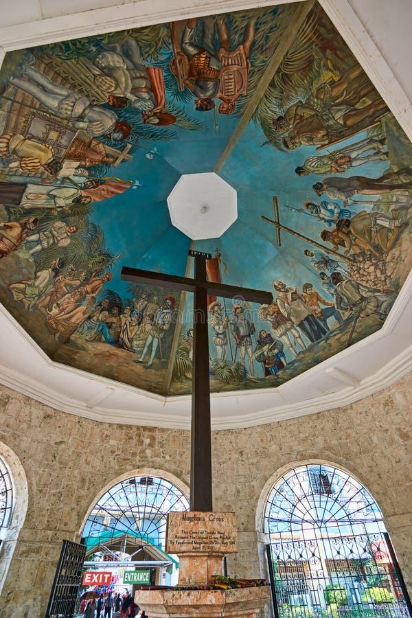 Magellan`s Cross in Cebu City, Philippines. CEBU CITY, PHILIPPINES - AUGUST 10, 2017: Magellan`s Cross in a chapel in Cebu City, Philippines. The original cross stock photo