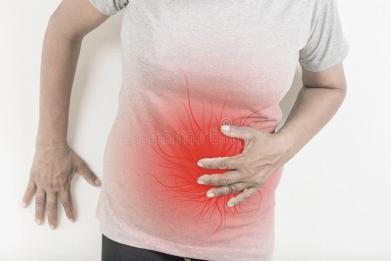 Magenschmerzen in den alten Frauen lizenzfreie stockfotos
