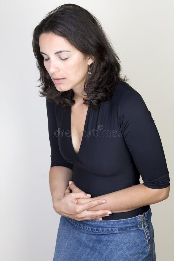 Magenschmerzfrau stockfotografie