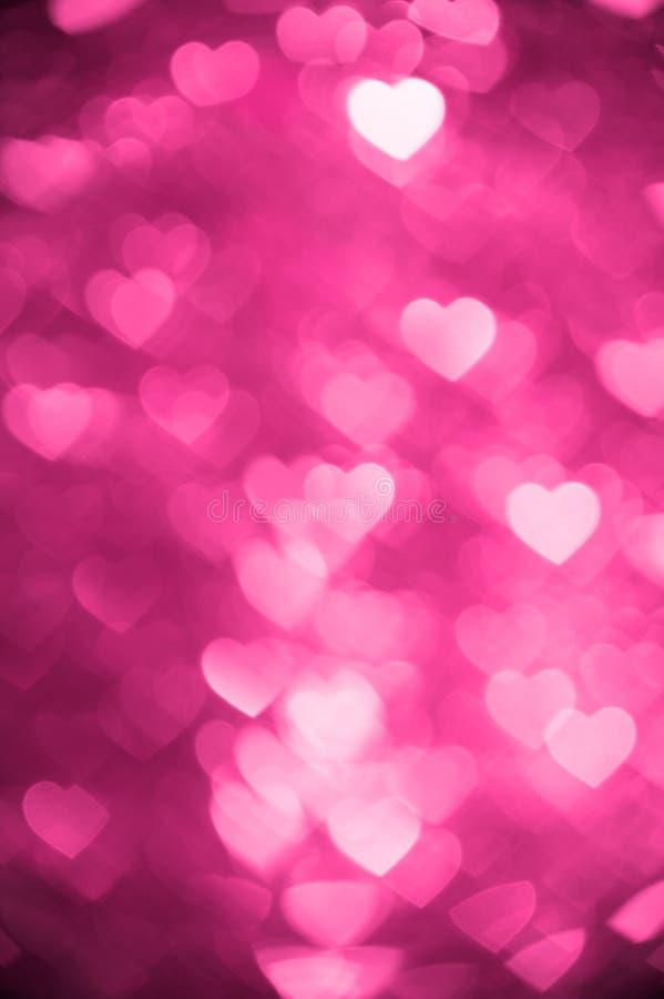Magenta color heart bokeh background photo. Abstract holiday, celebration backdrop. royalty free stock photo
