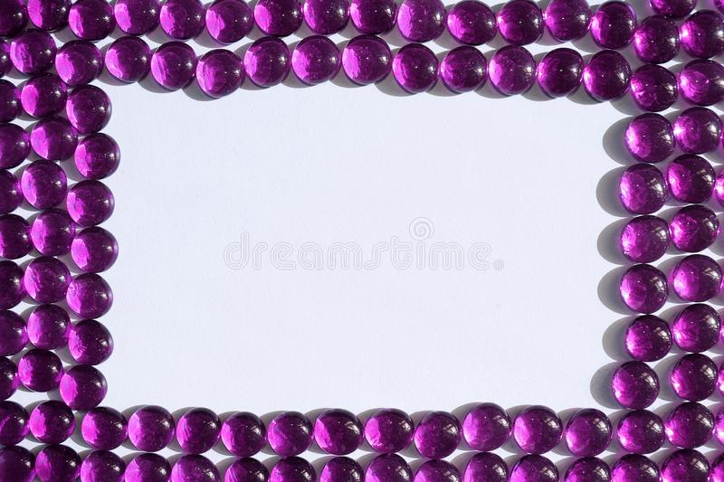 Magenta Glass Pebbles Frame. A frame of magenta glass pebbles stock photo