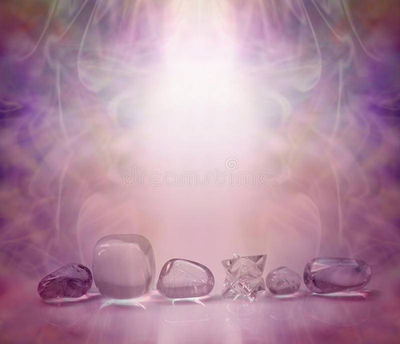 Magenta Healing Crystals. Single row of clear crystals and a Merkabah, bathed in a magenta energy light with a beautiful wispy background and copy space stock photography