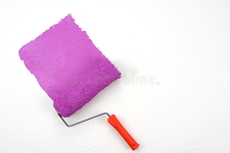 Magenta paint. Roller isolated with clipping path stock photo