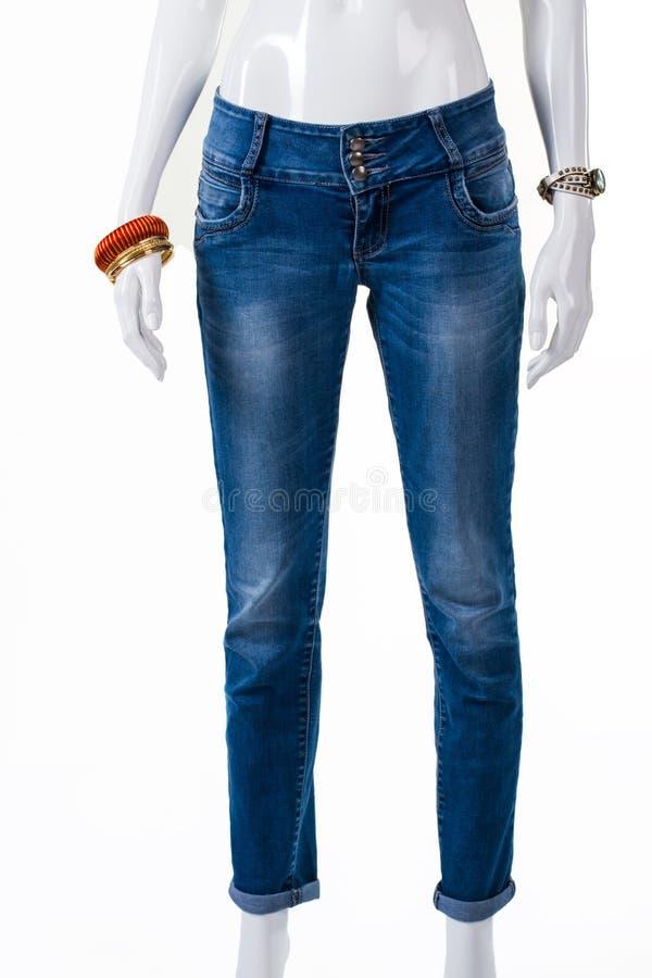 Magere jeans en polstoebehoren royalty-vrije stock fotografie