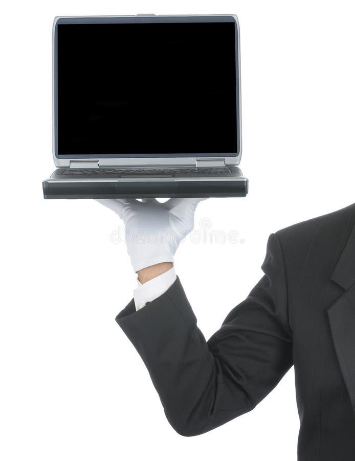 Maggiordomo con il computer portatile a disposizione immagini stock libere da diritti