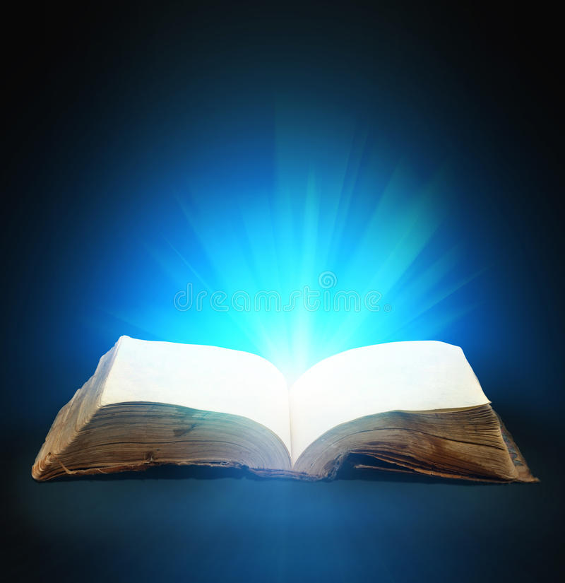 Magic book. Opened magic book with magic light for you design royalty free stock image