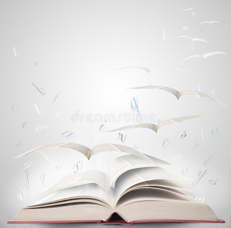 Magic book. Fly with fantasy reading a book royalty free stock photography