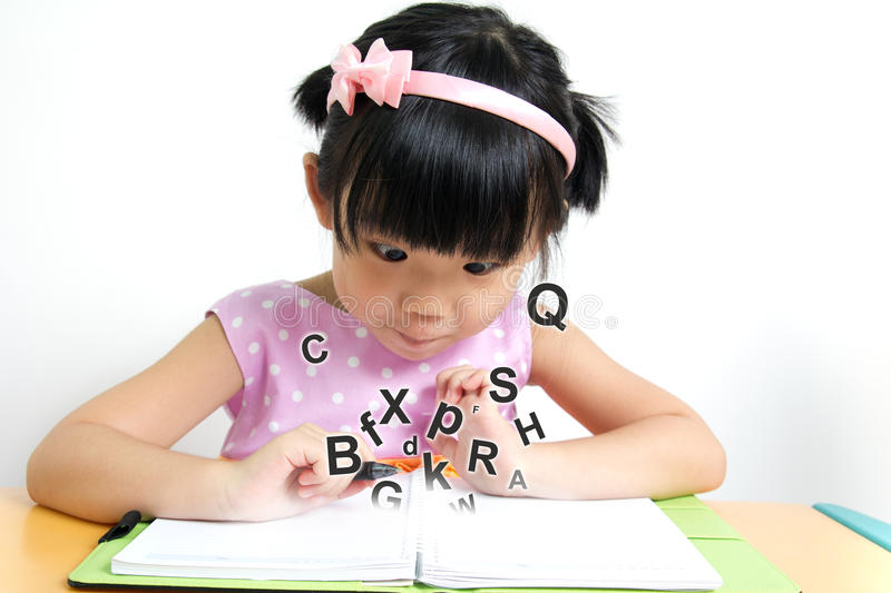 Magic book. Little girl looks surprise at magic book stock images